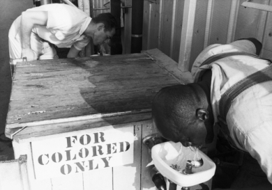 Segregated drinking fountain in use in the American South. Undated photograph.