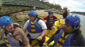 """Cultural Geography students taking a whitewater trip as they work to develop a """"History from the River"""" for the whitewater guides; Columbus, GA. Photograph: David Rush. 2014."""